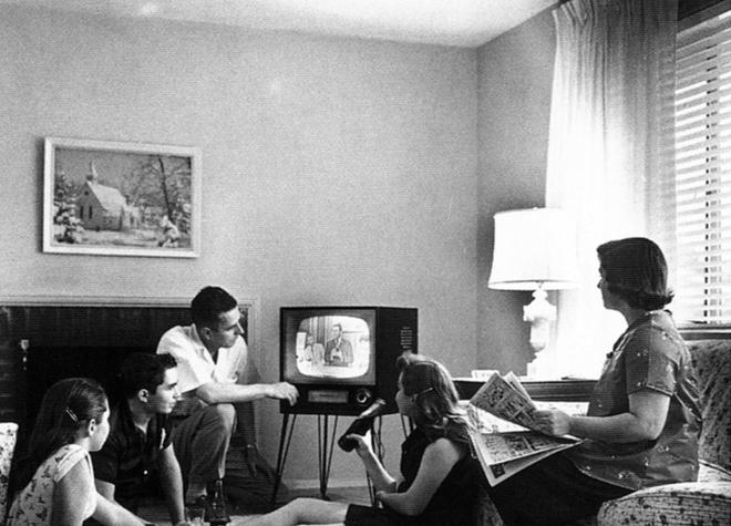 people sitting in front of a tv